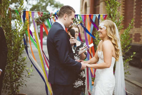 Bride and groom with colourful streamers