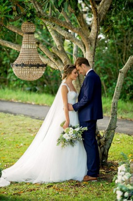 Bride and groom with fairy lit tree