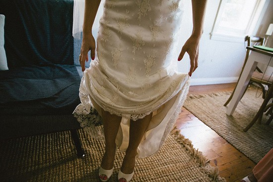 Bride in lace dress with white peeptoes