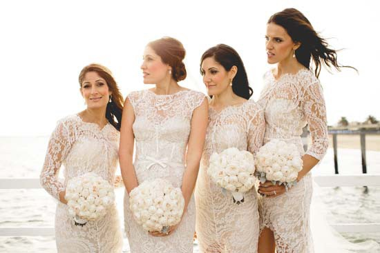 Bride with bridesmaids in white lace