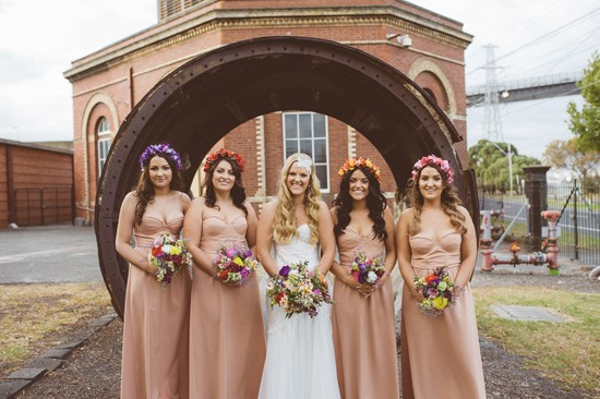 Bride with bridesmaids with multi coloured flower crowns