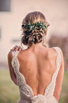 Bride with deep cut lace wedding gown