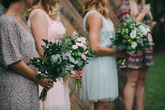 Bridesmaids in mismtached gowns