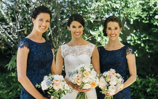 Bridesmaids in navy lace dresses