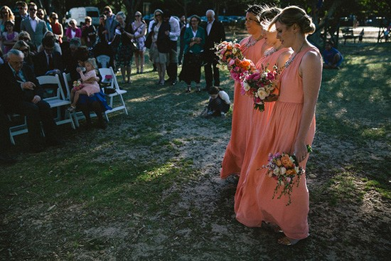 Bridesmaids in sweet apricot dresses