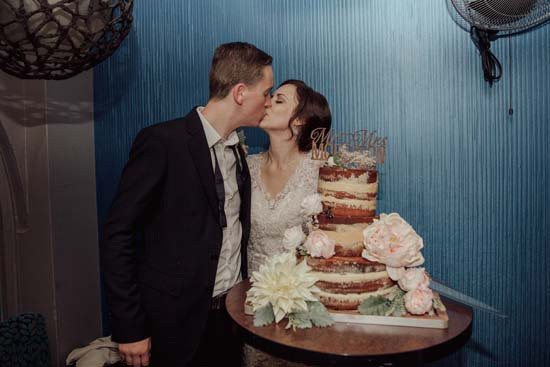 Canberra cutting wedding cake