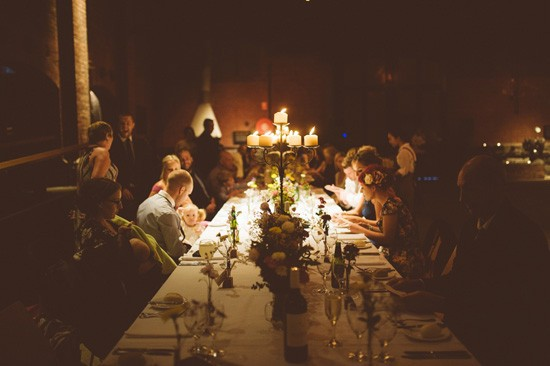 Candle lit industrial wedding reception
