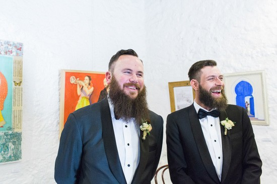 Groom and groomsmen awaiting bride