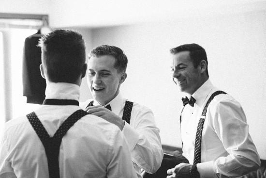 Groom and groomsmen getting reader