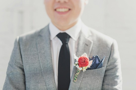 Groom in grey suit with black tie