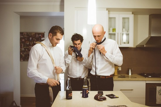 Grooom and groomsmen gettting ready