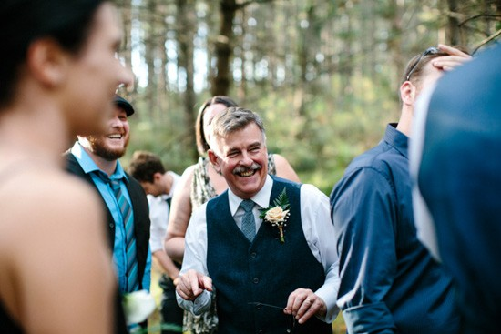 Happy guests at forest wedding