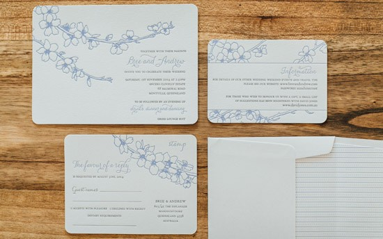 Letterpress wedding invitationd with blue flowers