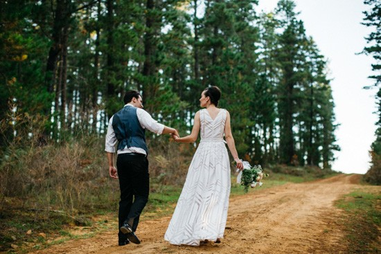 Newlyweds in pine forest