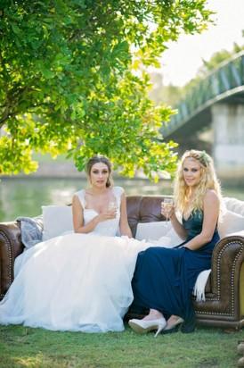 Waterside bride and bridesmaid
