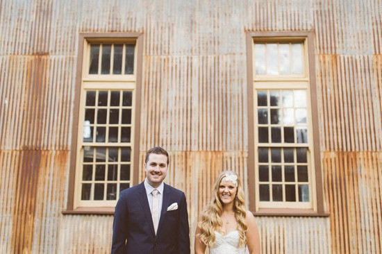 Wedding against rusted corrugated iron
