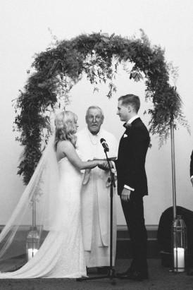 Wedding ceremony under greenert arch