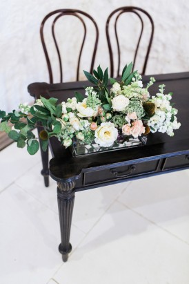White and green foliage arrangement for ceremony arrangement