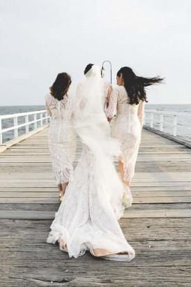bride and bridesmaids on pier