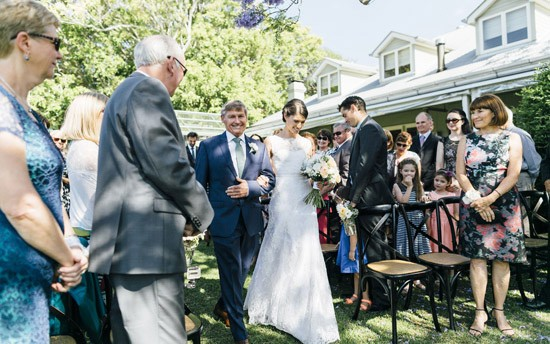 bride and father at garden ceremony