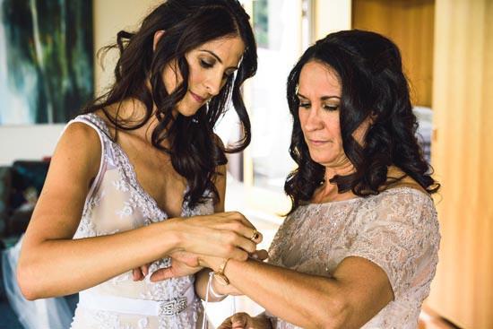 bride helping mum get ready