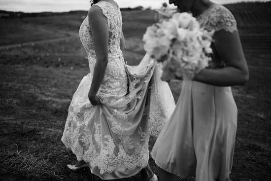 bride walking in lace wedding dress