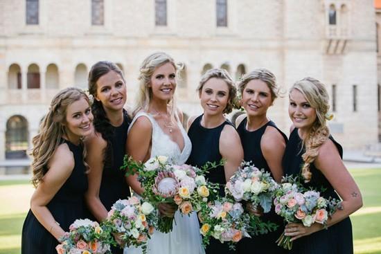 bride with bridesmaids in navy