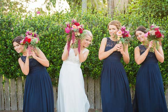 bride with bridesmaids in navy gowns