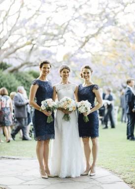 bride with navy bridesmaids