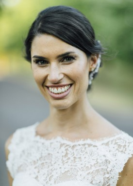 bride with swept back hair style