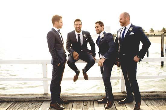 groom and groomsmen on pier