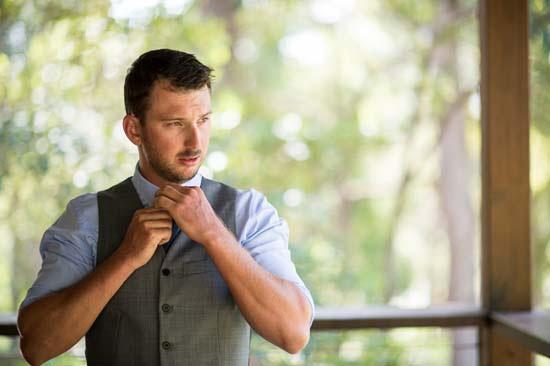 groom in blue shirt and waistcoast