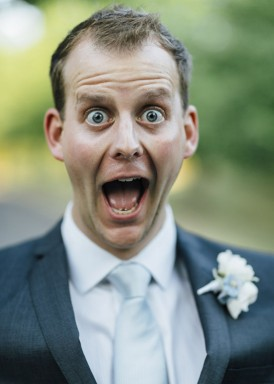 groom in gibson suit