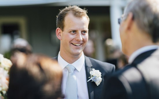 groom in gibson suit with pale blue tie