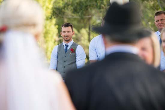 groom watching bride