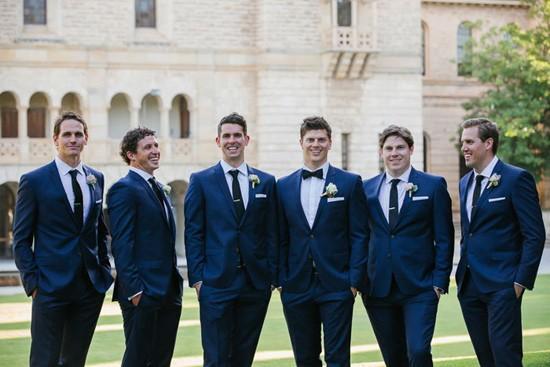 groomsmen in navy gibon suits