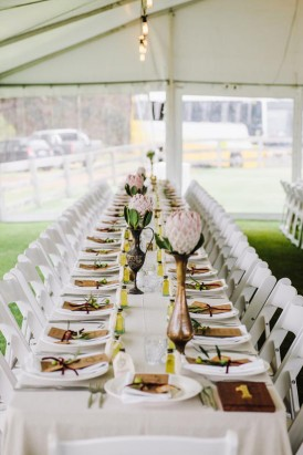 long wedding tables with brass vases