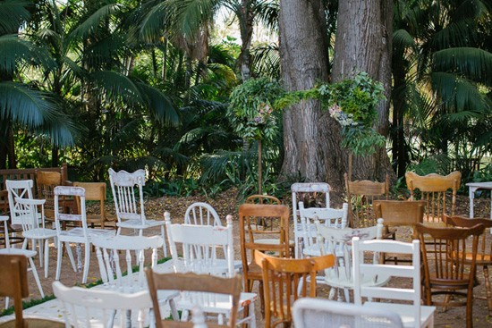 mismatched chairs at wedding ceremony