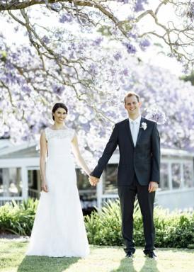 newlyweds with jacaranda tree