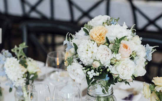 peach and white flowers at wedding