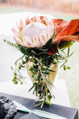 protea in brass vase