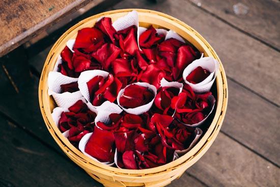 red rose petals at wedding
