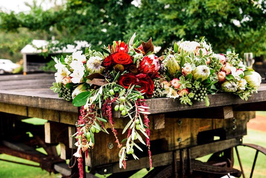 wagon decorated with flowers at wedding