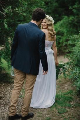 BBride showing dress to groom