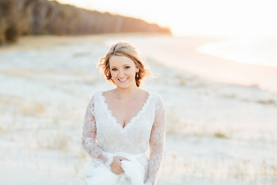 Beach bride with long sleeve gown