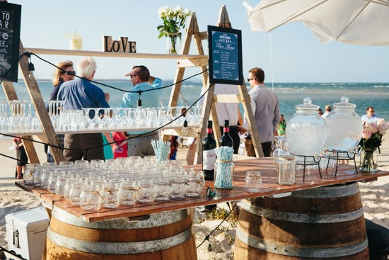 Beach wedding drinks station