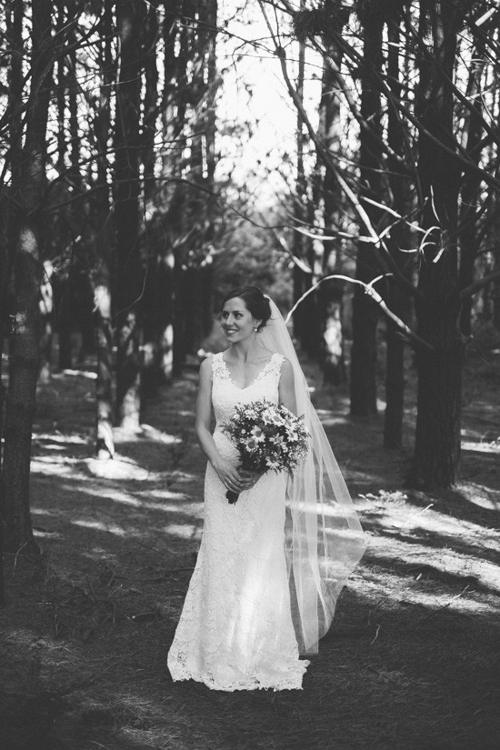 Black and white photo of bride in forest