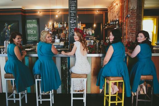 Bride and bridesmaids at bat