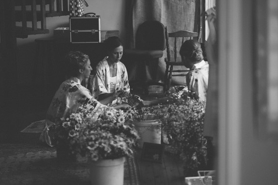 Bride and bridesmaids making bouquets