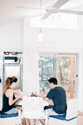 Bride and groom having breakfast